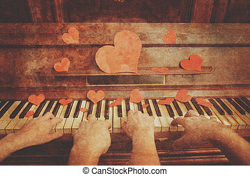 Couple playing on piano - Couple is playing on piano on...