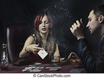 Couple playing poker - Couple - rich woman and man in suit...