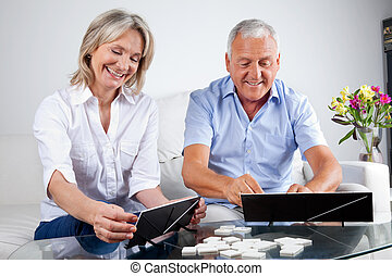 Couple Playing Rummy - Happy senior couple playing rummy ...