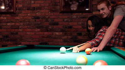 Couple playing snooker in night club 4k - Young couple...