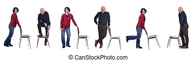 couple playing with a chair on white