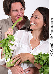 Couple playing with celery