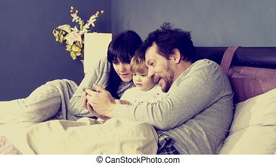 Couple playing with daughter