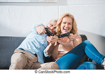 couple playing with joysticks
