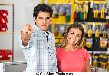 Couple Pointing At You In Hardware Store