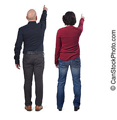couple pointing on white background