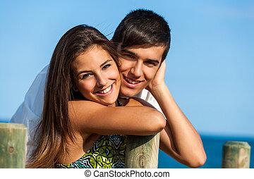 Couple portrait at beach.