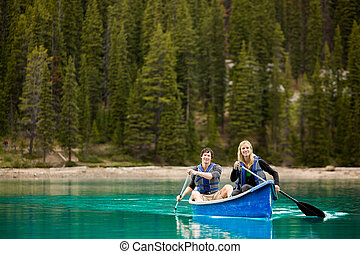 Couple Portrait in Canoe - A portrait of a happy copule in a...