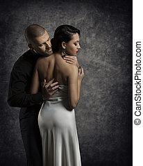 Couple Portrait, Man Woman in Love, Boy in Dark Embracing Elegant Girl in White Gown