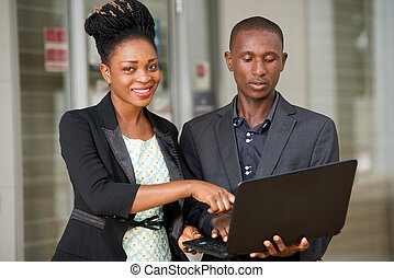 couple portrait of business people with a laptop