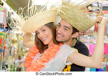 Couple posing in straw hats
