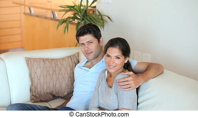 Couple posing on their sofa