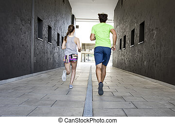 Couple practicing jogging in the city
