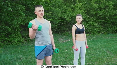 Couple practicing with a dumbbell