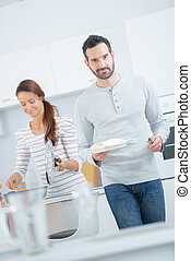 Couple preparing a home cooled meal