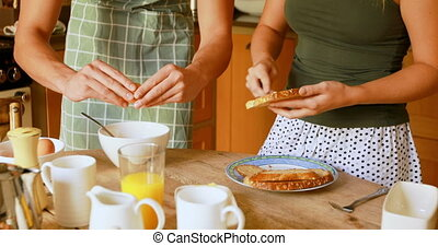 Couple preparing breakfast in kitchen at home 4k - Mid ...