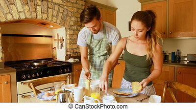 Couple preparing breakfast in kitchen at home 4k - Young ...