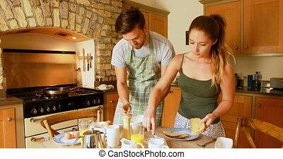 Couple preparing breakfast in kitchen at home 4k