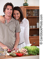 Couple preparing dinner in the kitchen