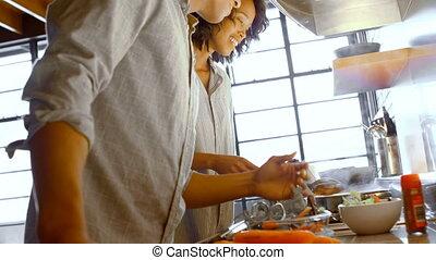 Couple preparing food in kitchen 4k