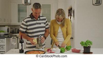 Couple preparing food in their kitchen
