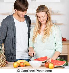 couple preparing fruit salad