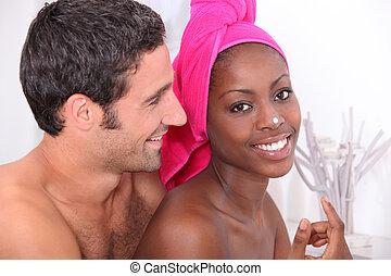 couple preparing in bathroom
