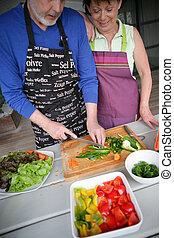 Couple preparing lunch alfresco