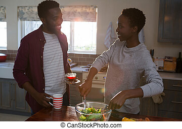 Couple preparing salad in the kitchen