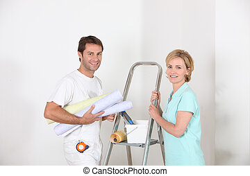 Couple preparing to wallpaper