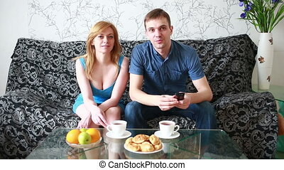couple preparing to watch a movie