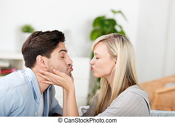 Couple Puckering Lips At Home