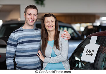 Couple purchasing a new car
