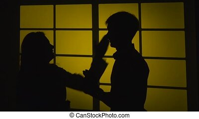 Couple quarrels and fights. Silhouette. Slow motion. Close up