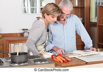Couple reading a cookbook