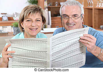 Couple reading a newspaper