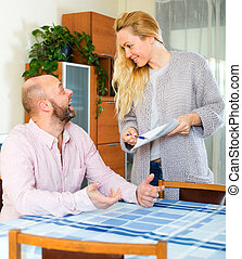Couple reading insurance contract