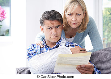 Couple Reading Letter About Man's Injury