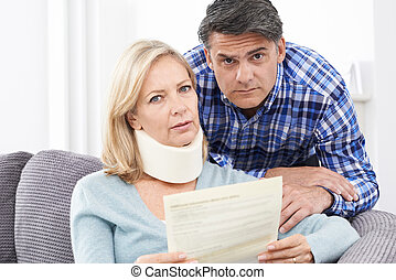 Couple Reading Letter About Woman's Injury