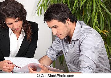 Couple reading through a report