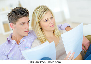 Couple reading through an important document