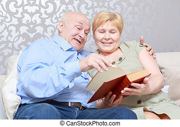 Couple reads a book at home
