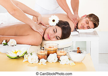 Couple Receiving Massage At Spa - Portrait of smiling young...