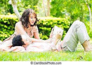 Couple relax in garden