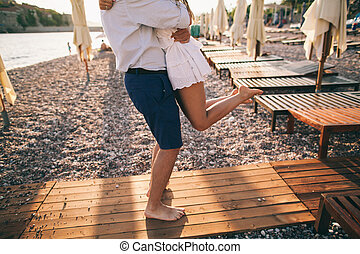 couple relax on beach together