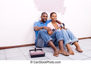 couple relaxing after painting
