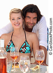 couple relaxing in a beach restaurant