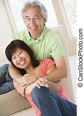 Couple relaxing indoors and smiling
