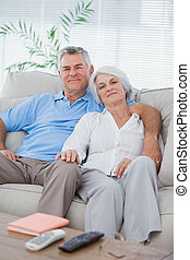 Couple relaxing on a couch