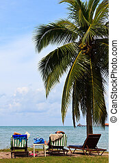 Couple relaxing on the beach of a tropical island